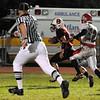 Salem: Captain Joey Dinh, center, runs for a touchdown after making a catch.  photo by Mark Teiwes / Salem News