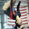 Middleton: Masconomet gymnast Julia Small dismounts the beam with a backflip.   photo by Mark Teiwes  / Salem News