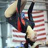 Middleton: Masconomet gymnast Julia Small dismounts the beam with a backflip.   photo by Mark Teiwes  / Salem News
