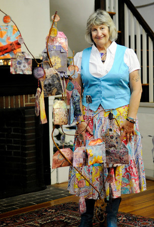 "Marblehead: Artist Holly Aloha Jaynes of Marblehead stands behind her piece entitled, ""Tea Bag Tree"".    photo by Mark Teiwes / Salem News"