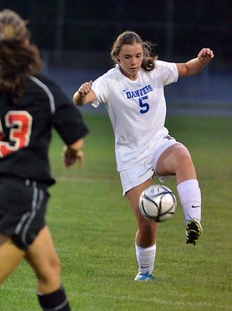 Danvers: Danvers defender Erin Loehner traps the ball. photo by Mark Teiwes / Salem News