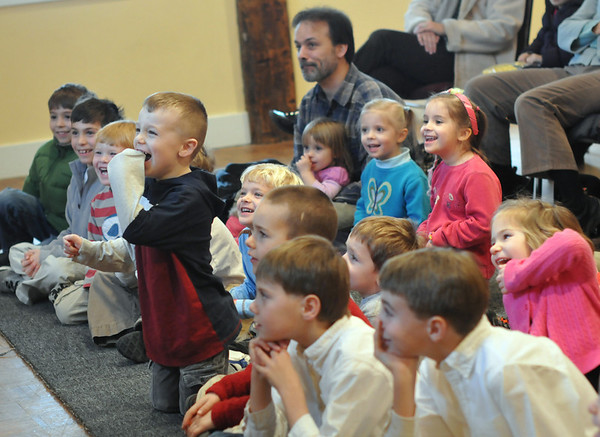 "Wenham: Children laugh during ""Awesome Robb's"" educational magic and song show at the Wenham Museum.   photo by Mark Teiwes  / Salem News"