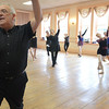 Salem: Gene Murray teaches an adult ballet class at his studio.    photo by Mark Teiwes / Salem News