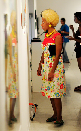 """Beverly: Massiel Grullon, a freshman at Montseratt, takes a close look at  """"The Morning Exciting"""" exhibition during a reception.  She is taking foundation classes but is interested in fashion.  photo by Mark Teiwes / Salem News"""