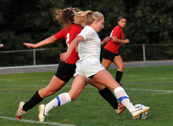Danvers:  Danvers High School girls soccer player Corey Persson, right, and Salem's Lauren Schaejbe fight for the ball.  photo by Mark Teiwes / Salem News