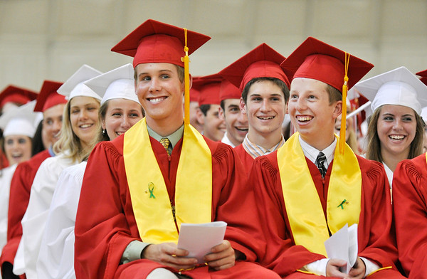 "Boxford: Masconomet graduates Scott Bermudez, left, and Benjamin Besse laugh in reaction to Ryan Madden's essay ""Observations of a Duck"" photo by Mark Teiwes / Salem News"