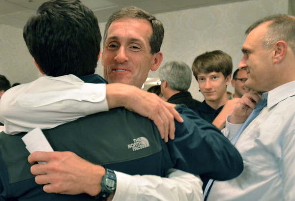 Beverly:  Mike Cahill hugs a supporter after hearing that he recieved the most votes in the preliminaries for the mayor of Beverly.  photo by Mark Teiwes / Salem News