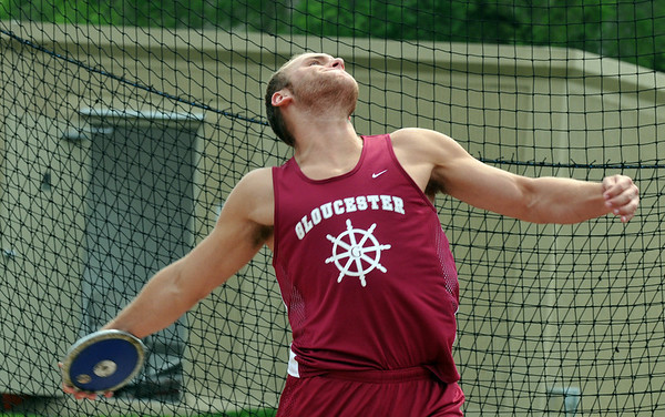 Lynn: At the Northeastern Conference track meet, Gloucester athlete Chris Unis spins and launches a discus.  Photo by Mark Teiwes / Gloucester Times