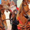 Beverly: Santa arrived to Beverly by horse-drawn carriage. photo by Mark Teiwes / Salem News