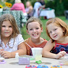 Hamilton:  Nanina Fabrizio, 5, Michaela Bartlett, 7, and Lily Ravins came with their mothers to Green Meadows Farm and also did some networking.  photo by Mark Teiwes / Salem News