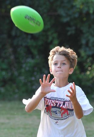 Salem:   Jaxon Thomas, 7, of Salem makes a catch.  photo by Mark Teiwes / Salem News