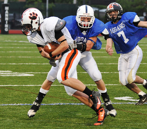 Lynn:  Beverly's Justin Marrs gains yardage for the south team at the 49th annual Agganis All-Staff Football Classic  photo by Mark Teiwes / Salem News