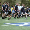 Danvers: St. John's Prep rugby captain Sean Sawyer, right, makes a kick for touch, similar to an out-of bounds punt in football moving the ball closer to the other team's goal.  photo by Mark Teiwes / Salem News