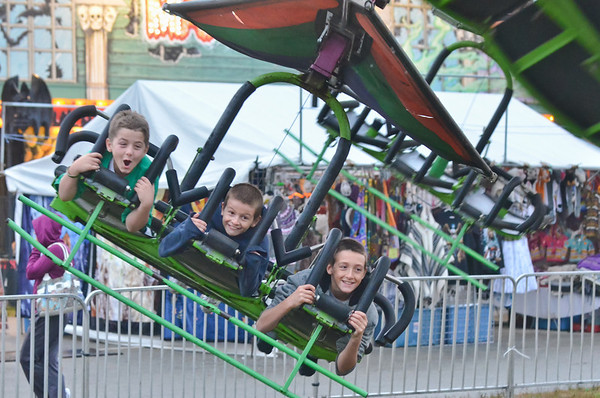 Topsfield: Cameron Lovering of Salem, 10, left, soars on a hanglider ride with Tommy St. Cyr, 10 and his brother John, 12, of Saugus Sunday at the Topsfield Fair.  photo by Mark Teiwes / Salem News
