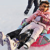 Salem: Making the most of the day off from school and the fresh powder snow, Diana Felix, 4, laughs and yells held by her sister Tiffany, 11, as they sled at Mack Park. photo by Mark Teiwes / Salem News