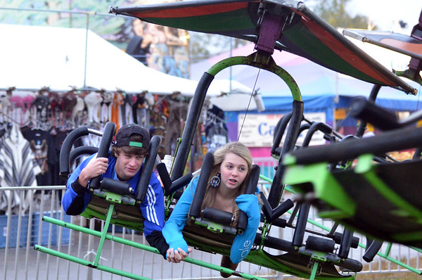 Topsfield: John Laut, 16, of Georgetown and Emma Adams, 15, of Newburyport soar on a hanglider ride Sunday at the Topsfield Fair.  photo by Mark Teiwes / Salem News