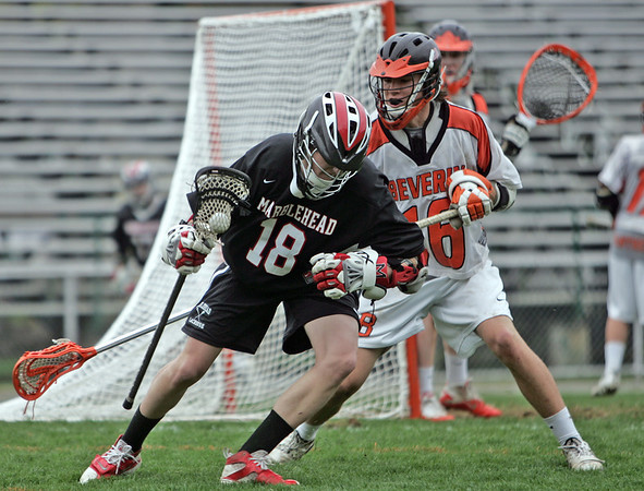 Beverly:  Marblehead's Sam Fox, left, carries the ball on the perimeter coved by Beverly's Ryan Caley.  photo by Mark Teiwes