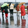 Danvers: A group heads out in the rain lead by Essex National Heritage Commission to look at the Endecott Pear Tree, the oldest living fruit tree in America.   photo by Mark Teiwes / Salem News