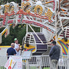 Topsfield: Fiesta Shows workers check over the set up of the zipper amusement ride for the Topsfield Fair. photo by Mark Teiwes / Salem News