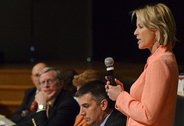 Hamilton: Jennifer Scuteri, chair of the Hamilton board of selectmen speaks at town meeting about concerns with the school budgets, particularly about special education funding.  photo by Mark Teiwes / Salem News