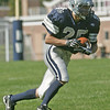 Hamilton: Hamilton-Wenham's Steve Turpin carries the ball on a kick off return.  photo by Mark Teiwes  / Salem News