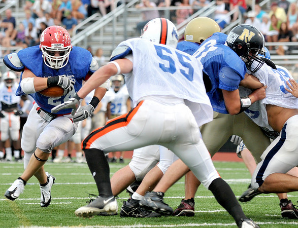 Lynn: Masconomet's Evan Bunker, left, carries the ball up field at the 49th annual Agganis All-Staff Football Classic  photo by Mark Teiwes / Salem News
