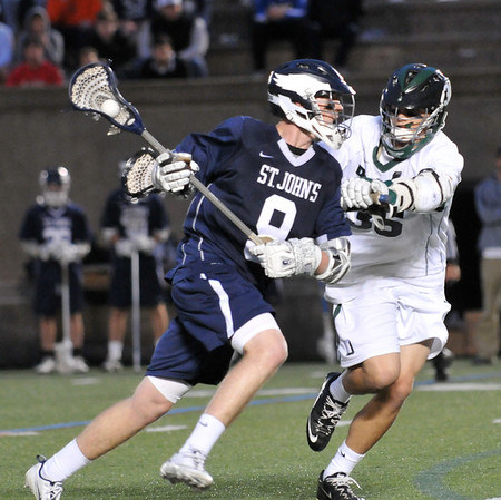 Boston: St. John's Prep player Jon Farrow drives past a Duxbury defender at Harvard Stadium photo by Mark Teiwes
