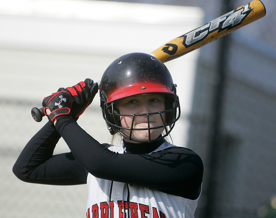 Marblehead: Marblehead co-captain, Emmy York, works on her swing.  photo by Mark Teiwes / Salem News