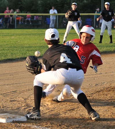 Peabody:  Boxford's Chase Zurnich slides safe into third base covered by West Beverly's Matt Townsend.    photo by Mark Teiwes / Salem News