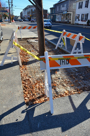 Ipswich: The town of Ipswich is re-doing several portions of the sidewalks along Central Street because a person slipped and fell and is now suing the town. photo by Mark Teiwes / Salem News