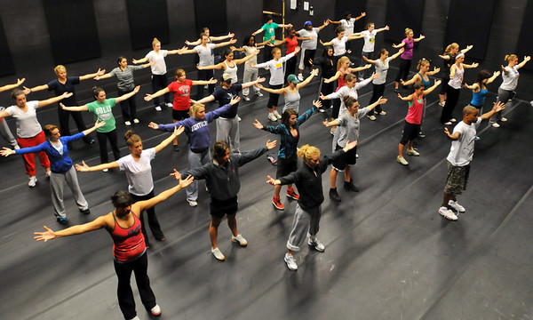 Beverly: The group stretches preparing themselves for some street dance moves. photo by Mark Teiwes / Salem News