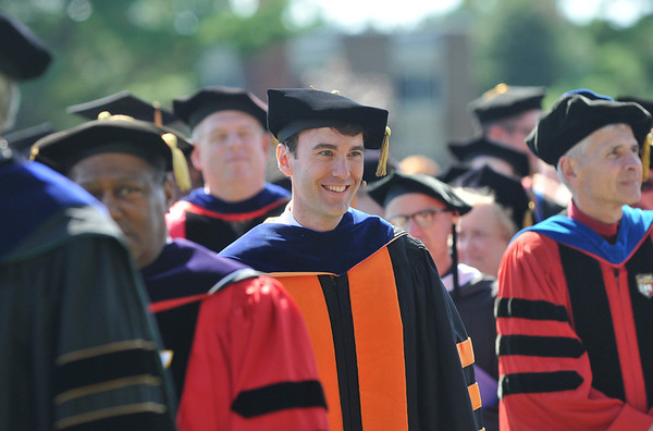 Wenham:  Dr. D. Michael Lindsay walks in a processional to be inaugurated as the new president of Gordon College. photo by Mark Teiwes / Salem News