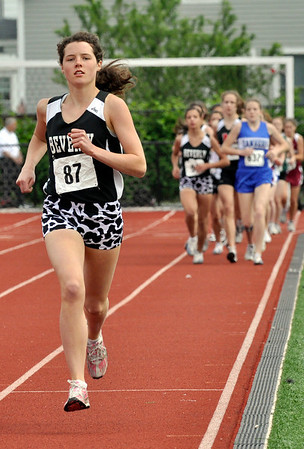 Lynn: At the Northeastern Conference track meet, Beverly runner Millie Chapman pushes for a strong lead during the two mile race finishing first for a time of 11:02.  Photo by Mark Teiwes / Salem News