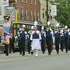 Danvers: Baton twirler Katie Yeaton leaps leading the Danvers High School Marching band down Maple Street in the memorial day parade.  photo by Mark Teiwes / Salem News