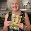 """Danvers:  Donna Eovacious holds a cookbook the seniors at the Danvers Senior Center published called """"Tried and True Treasures.""""   photo by Mark Teiwes / Salem News"""