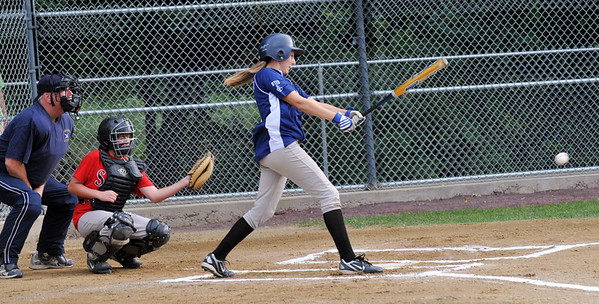 Danvers: Rockford Peaches player Ashley Ghostlaw follows through for a base hit.  photo by Mark Teiwes / Salem News