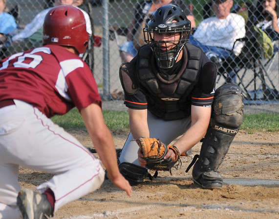 Beverly: Beverly catcher Joe Wioncek stares down Gloucester's Gilbert Brown ready to tag him out at home. photo by Mark Teiwes / Salem News