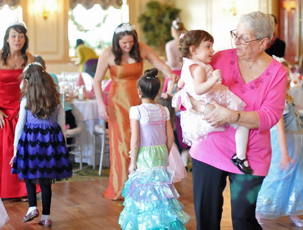 Salem:  A stead flow of music kept Susan Joneson of Winchester, right, on the dancefloor with her 1-year-old granddaughter Libby Melkonian.   photo by Mark Teiwes / Salem News