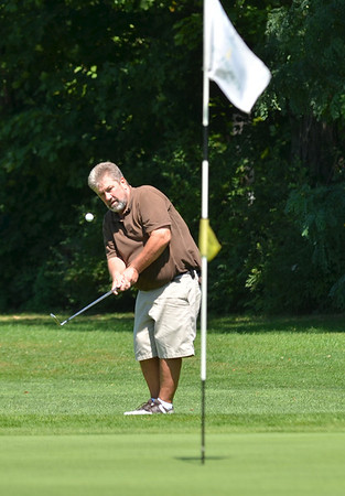 Boxford: Wayne Janian of Salem hits a chip shot on the 18th hole in the North Shore Amateur golf tournament at the Far Corner golf course.  photo by Mark Teiwes /  Salem News