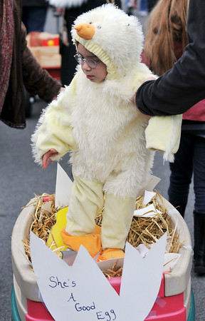 Beverly: Baby chick Justine Cirelli, 2, hatches from her shell.  photo by Mark Teiwes / Salem News