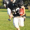 Hamilton: Mark Calder, 12, makes a run at a Hamilton-Wenham Youth Football practice.   photo by Mark Teiwes / Salem News