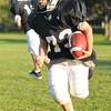 Hamilton: Mark Calder, 12, makes a run at a Hamilton-Wenham Youth Football practice.   photo by Mark Teiwes / Salem News