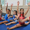 Danvers: Yellow Jacket gymnasts from right, Emerson Nicholas, 8, Skylar Davis, 9, Kate Keenan, 8, Zola Melville, 8, Ivy O'Connell, 9, and Gabriella Torres, 8, stretch during practice.