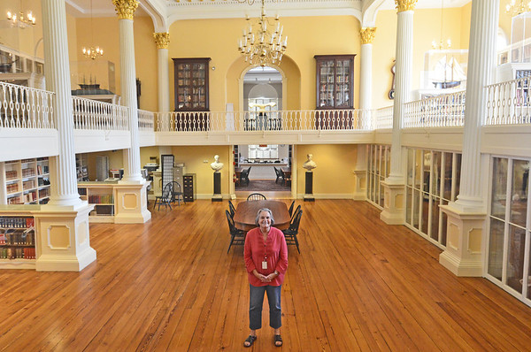 Salem:  Barbara Kampas, head of Phillips Library collections at the Peabody Essex Museum, stands in Plummer Hall of the Phillips Library.  The library will undergo a two-year $20 million monderinzation. photo by Mark Teiwes / Salem News