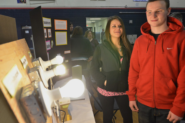 Middleton: According to Hannah Louf and Andrew Gallione's North Shore Tech freshman science fair project, despite the high cost, LED light bulbs are best because they give off the least heat and last up to 46 years.  photo by Mark Teiwes / Salem News