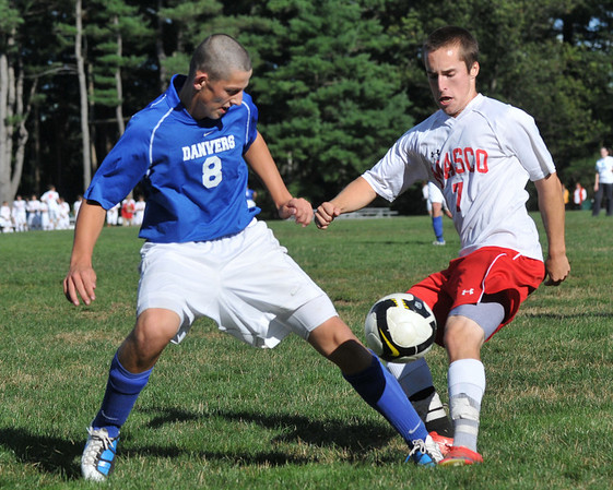 Topsfield: Danvers High School boys varsity soccer #8 captain Eric Martin, left, challenges a 50-50 ball with Masconomet's Charlie Behrens.  photo by Mark Teiwes / Salem News