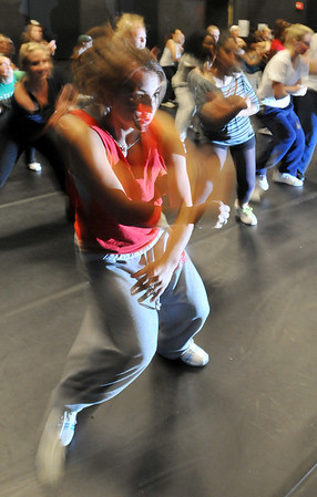 Beverly: Taylor Hage, Endicott College junior, moves in sync with a group as they learn an urban dance routine.  She is on the school's dance team. photo by Mark Teiwes / Salem News
