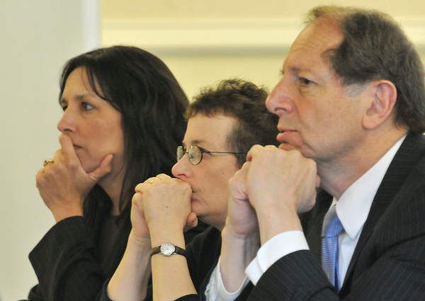 Salem: Mayor Kim Driscoll, left,  Barbara Warren, Salem Sound Coastwatch Executive Director, and Jim Smith of Salem Harbor Station, listen to consultants present plans for the future of the Salem Harbor Station.  Mark Teiwes / Salem News