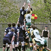 Danvers: St. John's Prep rugby team, left, hoists a teammate into the air for a throw-in with Bishop Hendricken of Rhode Island. photo by Mark Teiwes / Salem News