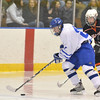 Salem: Danvers forward Jack McCarthy, left, scored one of Danvers' three goals.  Beverly's Brendan Mitchell, right, follows the play.  photo by Mark Teiwes  / Salem News